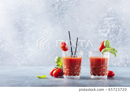 Vegan tomato juice with basil and peppe 65723720