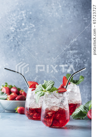 Red cocktail with ice and fresh strawberry 65723727