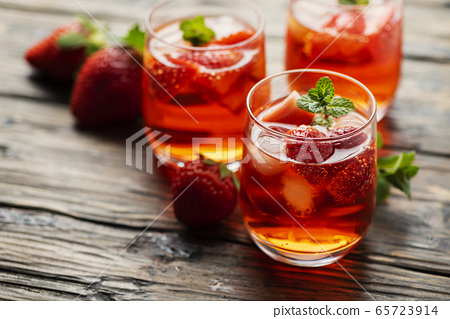 Fresh summer cocktail with ice, strawberry and 65723914