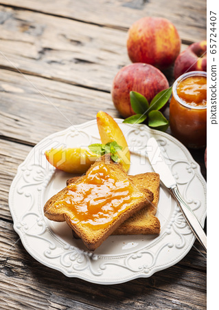 Healthy breakfast with toast and peach jam 65724407