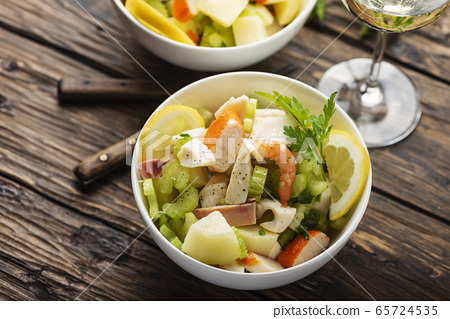 salad with seafood, potato and celery 65724535