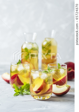 Summer cold tea with peaches and mint 65724870
