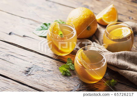 Cold tea with orange 65726217