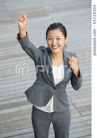 Businesswoman celebrate success 65728104