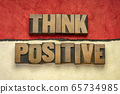 Think positive word abstract in wood type 65734985