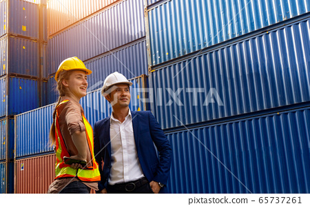 Two foreman, a woman and a man, stand together and 65737261