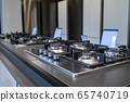 Brand new gas stoves and refrigerators home appliance retail store 65740719