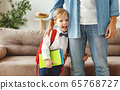 happy laughing child a little boy with a school 65768727