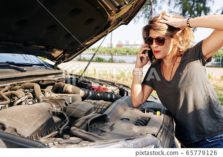 Woman calling to car service 65779126
