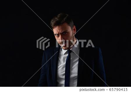 Close up portrait young man businessman. Caucasian 65790415