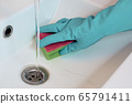 cleaning in the bathroom. Cleaning the sink. 65791411
