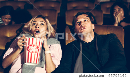 People audience watching movie in cinema theater. 65795142