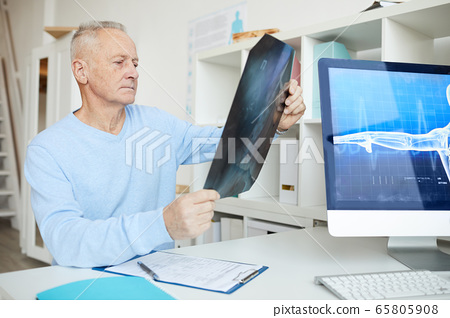 Senior Man Holding X Ray Image 65805908