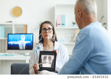 Doctor Pointing at X Ray 65805910