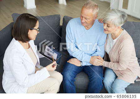 Senior Couple visiting Pulmonologist 65806135