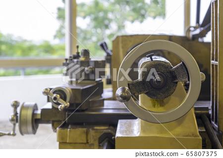 Machine work shop with grinder machine and bench 65807375