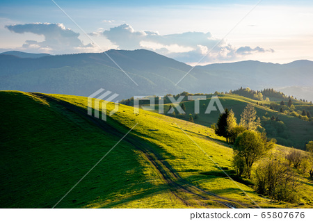 path through countryside fields. beautiful view of 65807676