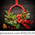 Christmas wreath on dark wooden background 65813539