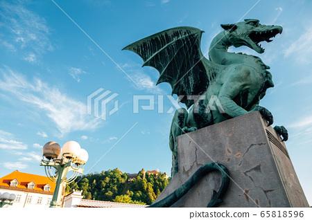 Dragon Bridge and ljubljana castle in Slovenia 65818596