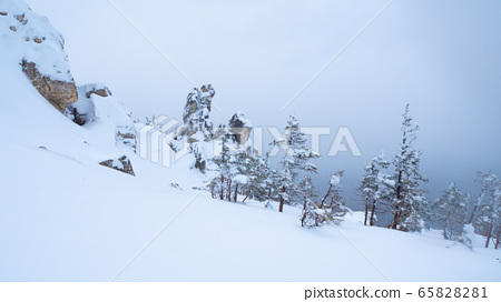 Snow-capped peaks of Taganai National Park located in the South Urals. 65828281