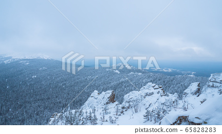 Snow-capped peaks of Taganai National Park located in the South Urals. 65828283