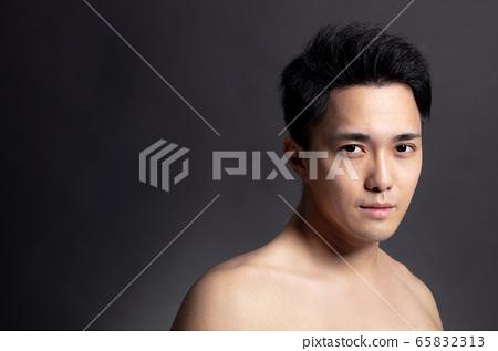 Closeup  of attractive young asian man face 65832313