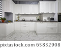 Clean and minimalistic modern white kitchen interior 65832908