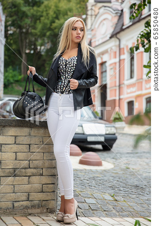 Young nice woman posing on the street 65850480