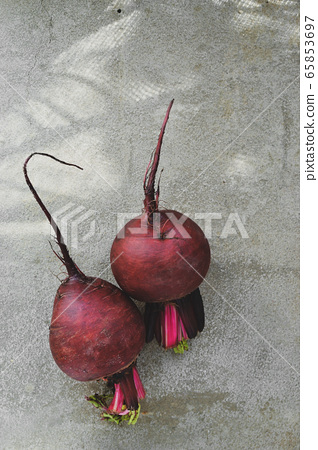 Summer harvest. Beets on a concrete background. Whole beets. Top view. Free space for text. Tasty and healthy vegetables. Concrete background 65853697