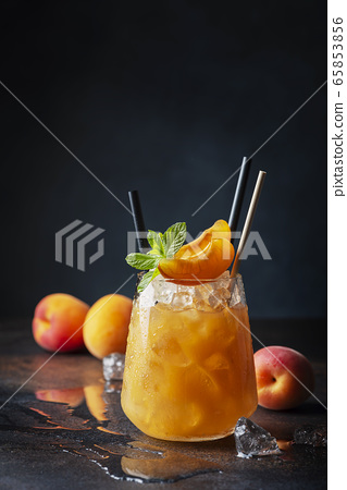 Fresh apricot cocktail with ice and mint 65853856