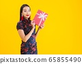 Portrait beautiful young asian woman wear chinese dress with red gift box 65855490
