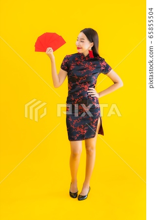 Portrait beautiful young asian woman wear chinese dress with Ang Pao or red letter with cash 65855504
