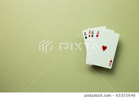 Four aces cards on khaki green background. top view, copy space 65855646