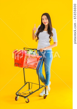Portrait beautiful young asian woman shopping grocery from supermarket and cart 65856600