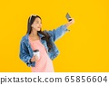 Portrait beautiful young asian woman with coffee cup and smart mobile phone 65856604