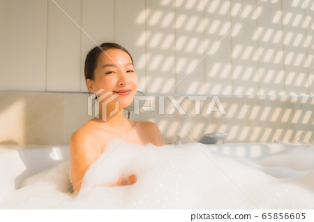 Portrait young asian woman relax take a bath in bathtub 65856605