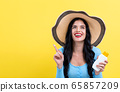 Young woman with sunscreen 65857209