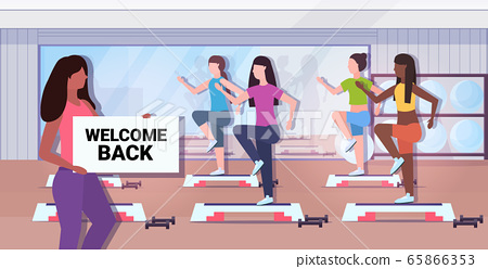 fitness trainer holding welcome back sign board coronavirus quarantine is ending victory over covid-19 65866353