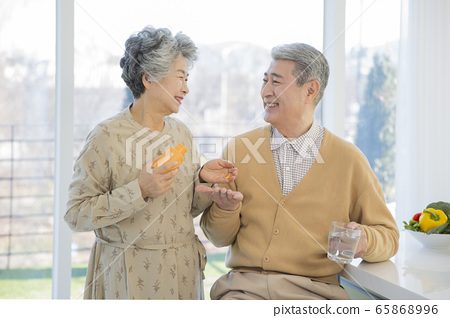 Happy senior life concept. Healthy activities in daily life of senior couple 210 65868996