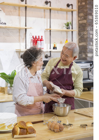 Happy senior life concept. Healthy activities in daily life of senior couple 250 65869010