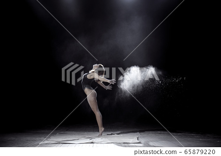 Girl dancing with a flour 65879220
