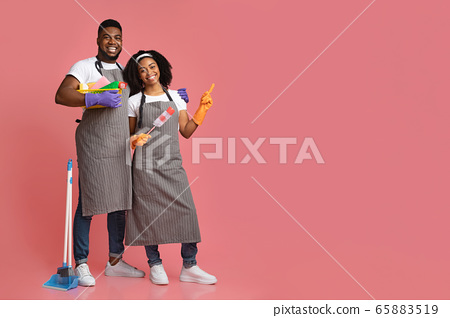 Cleaning Service Ad. Black Couple With Household Supplies Pointing At Copy Space 65883519