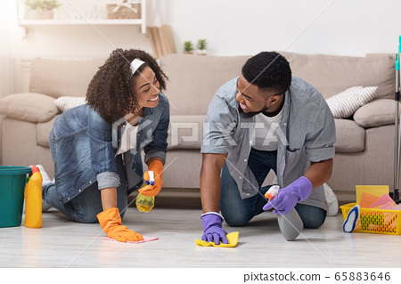 Household Concept. Young Black Couple Doing Spring Cleaning In Their Flat Together 65883646