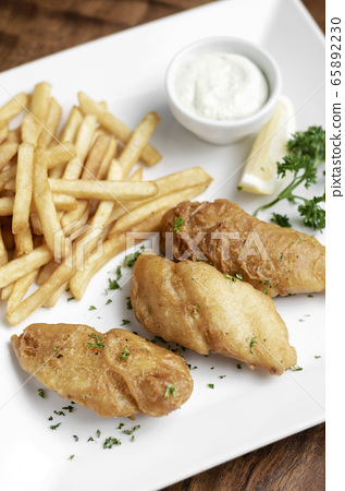 british traditional fish and chips meal on plate 65892230