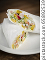 crab mayonnaise and salad wrap on wooden table 65892539