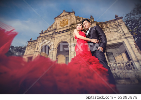 Man in black suit and Beautyful woman wearing 65893878