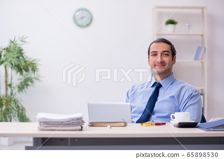 Young male employee in the office 65898530