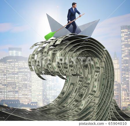 Businessman riding paper boat in dollar sea 65904010