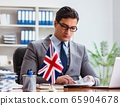 Businessman with British flag in the office 65904678