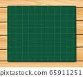 Cutting Mat on wood texture background. Green Cutting Mat. 65911251